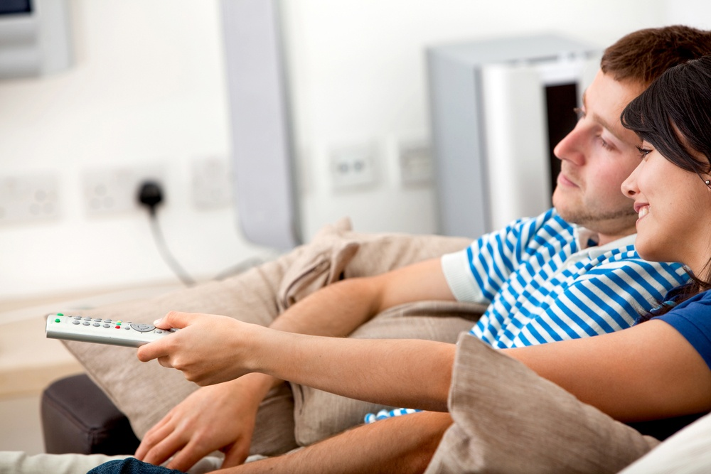 Loving couple at home relaxing watching tv.jpeg